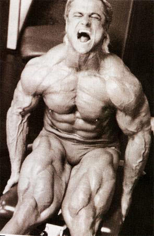 Tom Platz training his legs showing his muscular size and definition on his trademark legs for all to see.