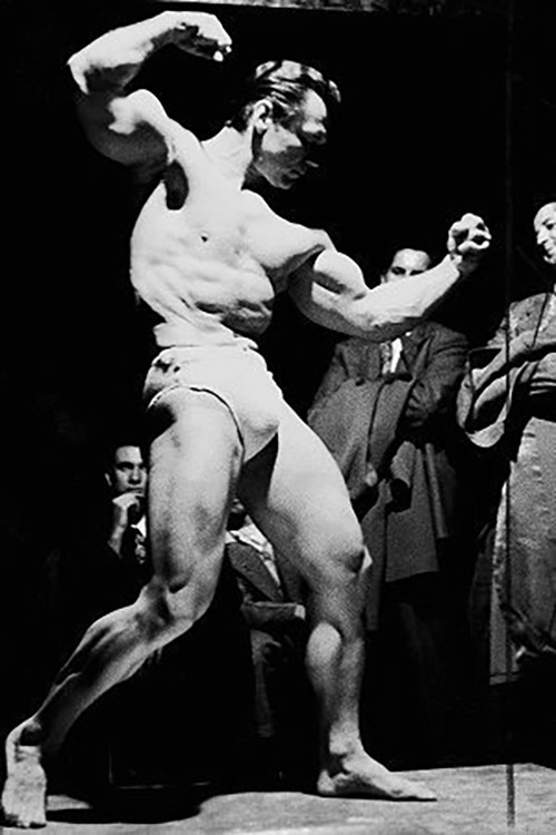 John Grimek Posing in front of crowd