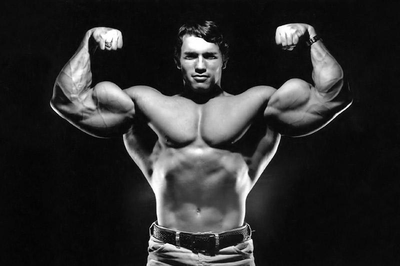 Arnold Schwarzenegger flexing biceps
