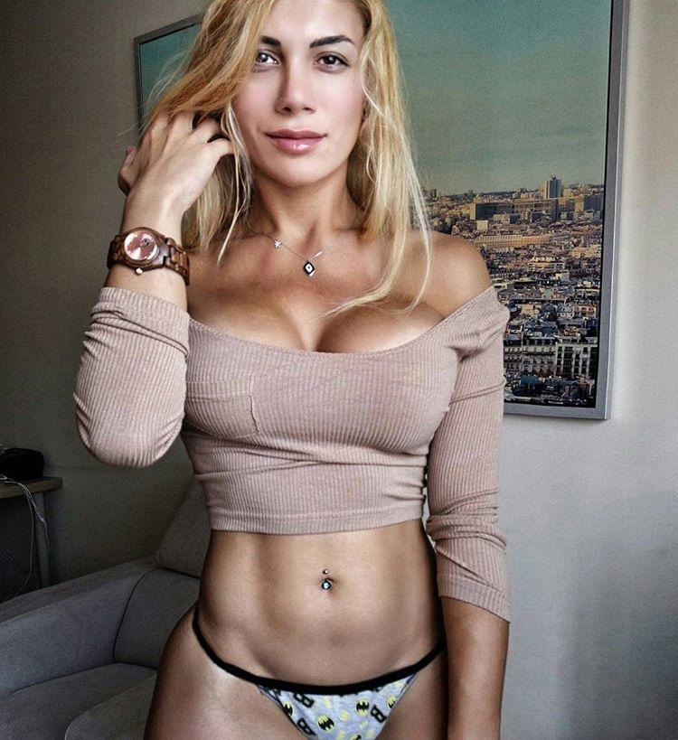 Femme Felis wearing her underwear looking lean and strong