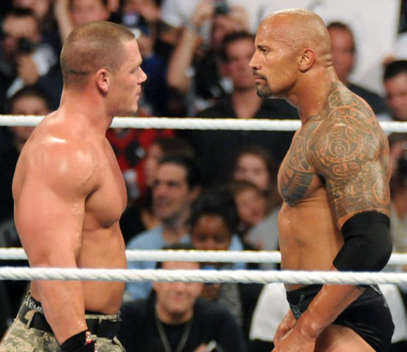 Dwayne Johnson The Rock facing John Cena in a ring