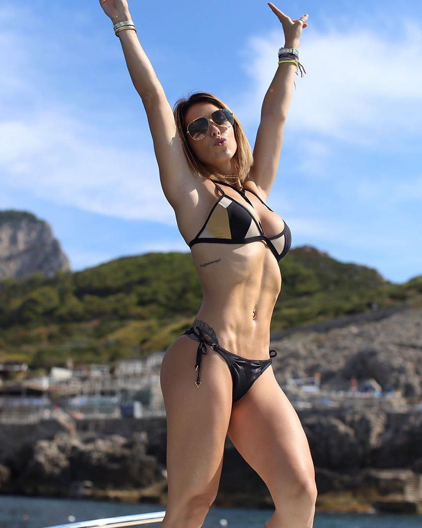 Bella Falconi holding her hands in the looking lean and healthy