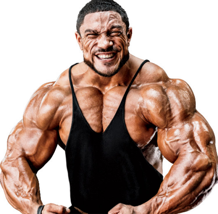 Roelly WInklaar in the full muscular pose, displaying his shredded physique.