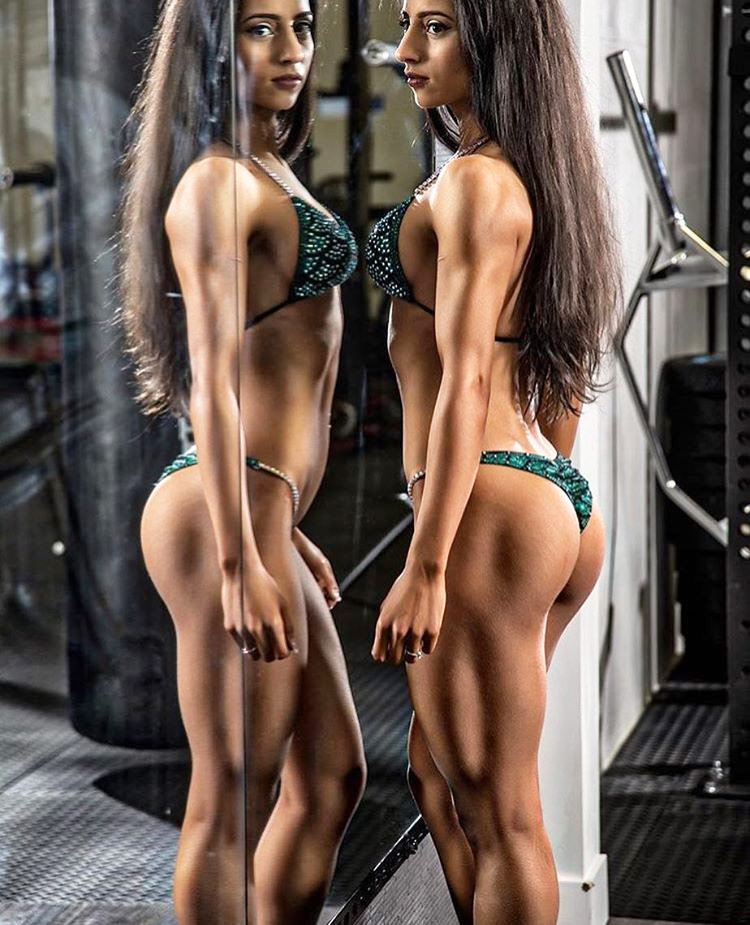 Sarah Ramadan's fitness photography shoot, modelling in a bikini standing opposite a mirror.
