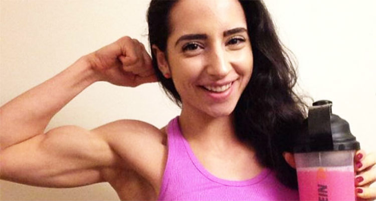 Sarah Ramadan proudly presenting her bicep - showing her muscle gains.