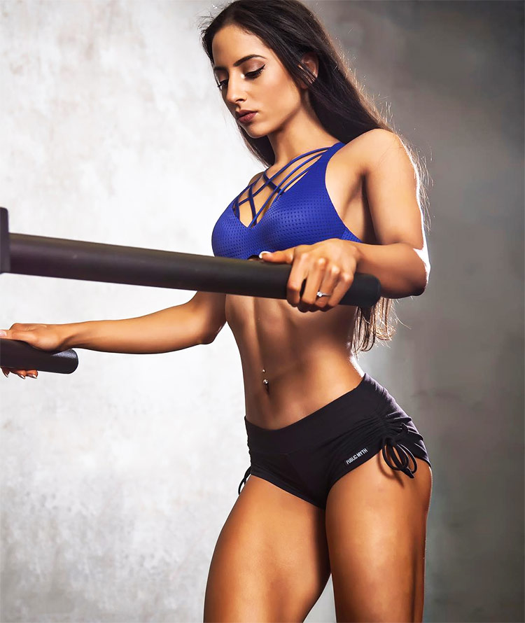 A professional photograph of fitness icon and social media star, Sarah Ramadan in sportswear.