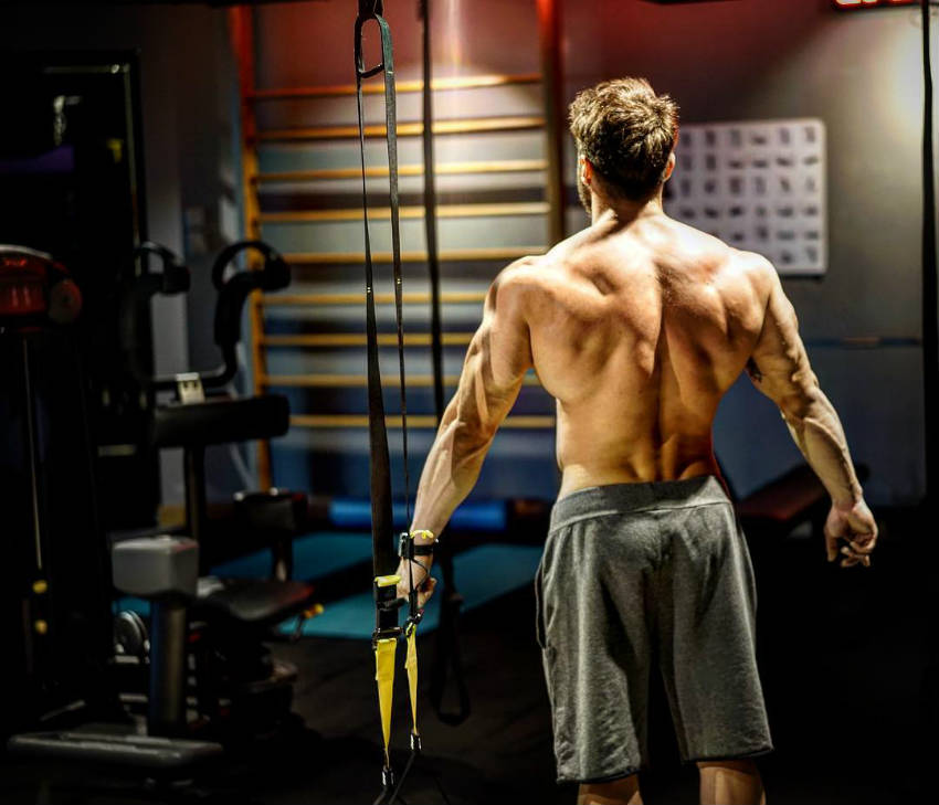 halim baydur stands in the gym showing his back to the camera