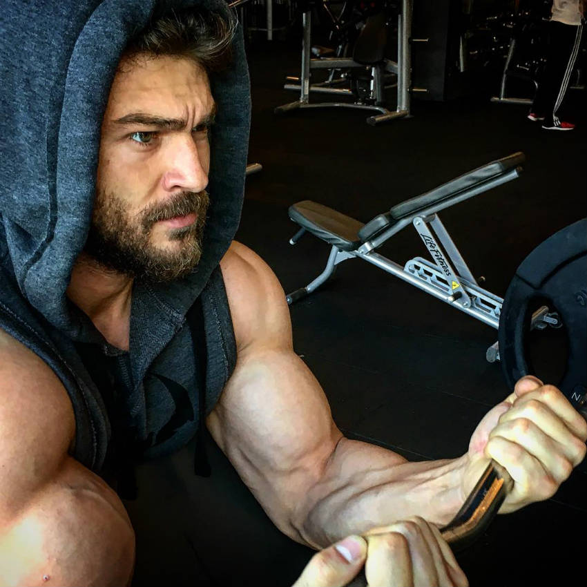 halim baydur completing a bicep workout