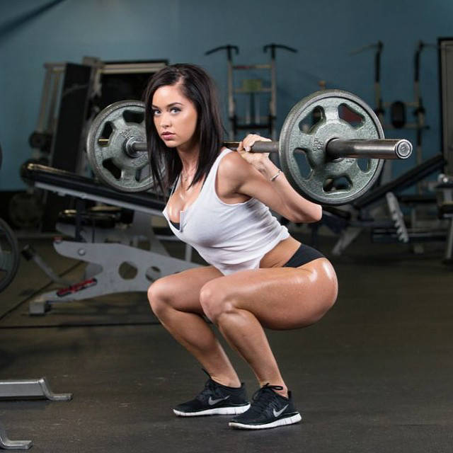 katy hearn completing squat in the gym with a barbell