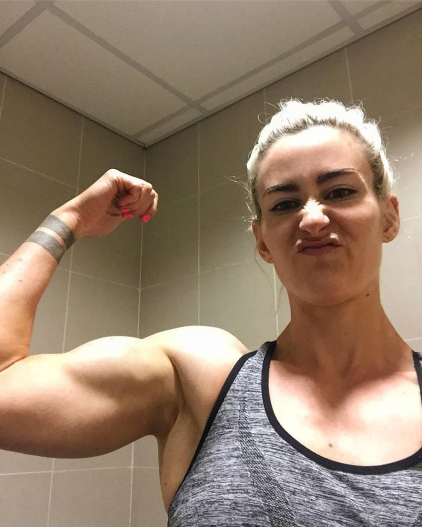 lucy sewell flexing bicep
