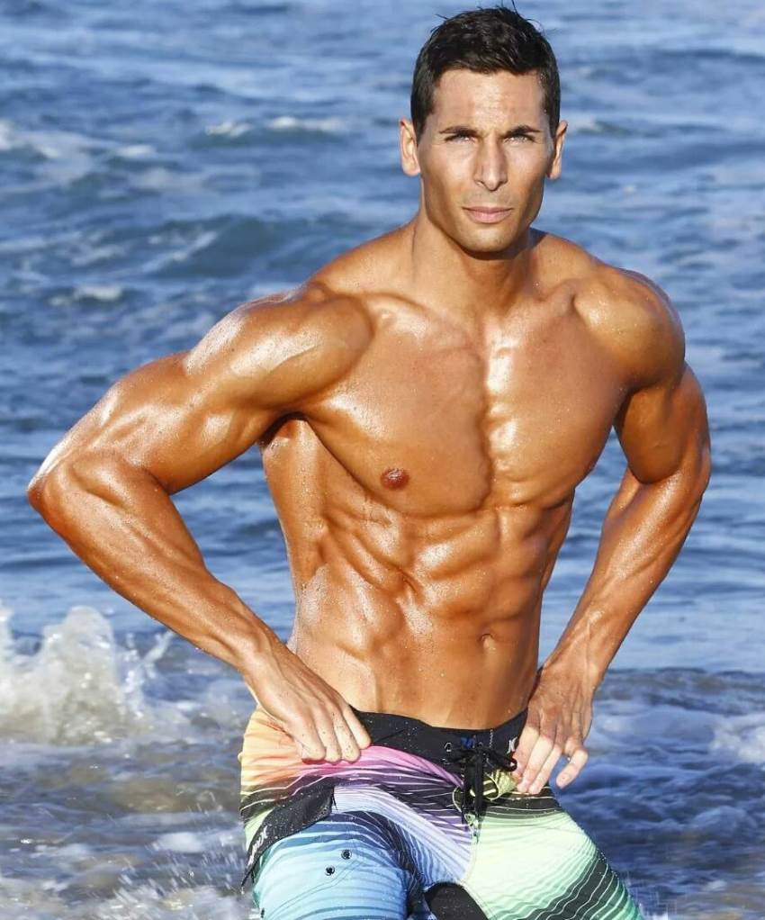 mike raso on a beach in the ocean