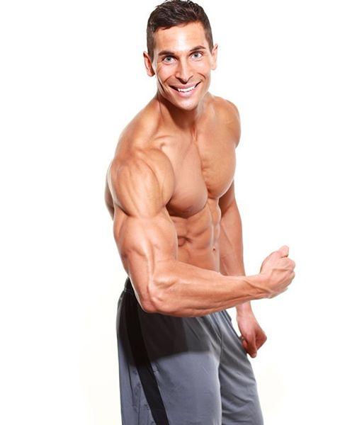 mike raso flexing biceps