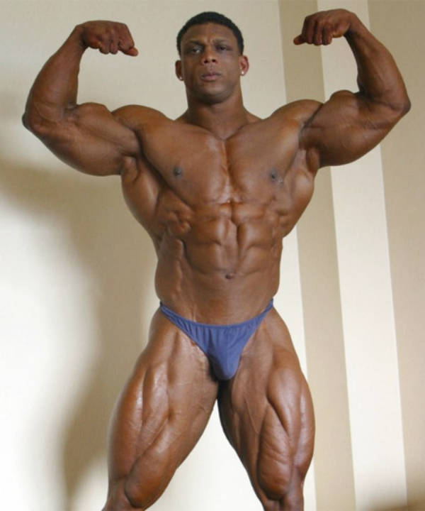 quincy taylor wears blue trunks and flexes his arms