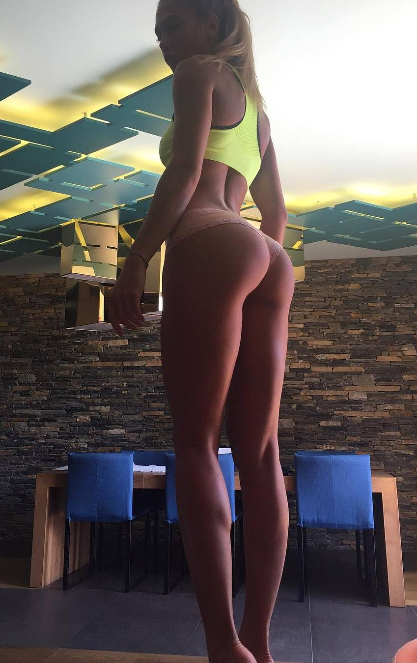 Rida Kashipova standing in a bikini showing off her toned legs and glutes
