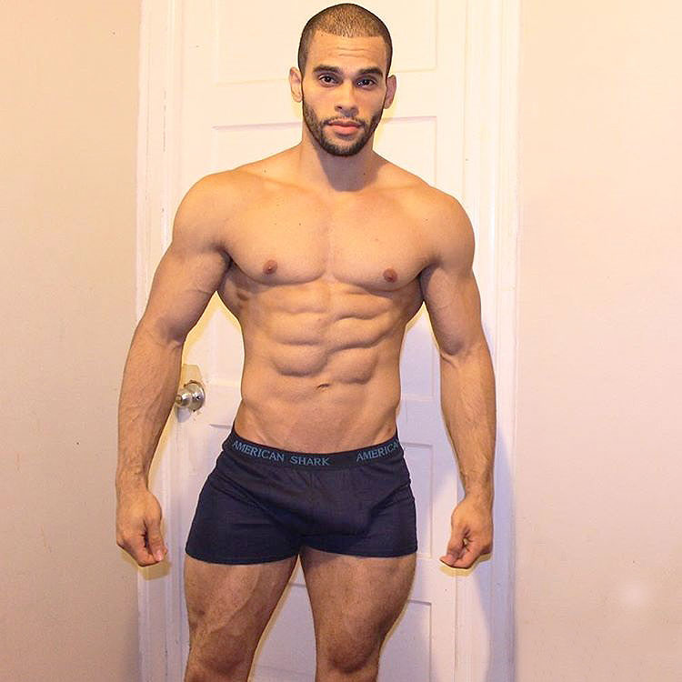 Alex Los Angeles standing in his underwear at home looking muscular and ripped with large quads, chest, and arms