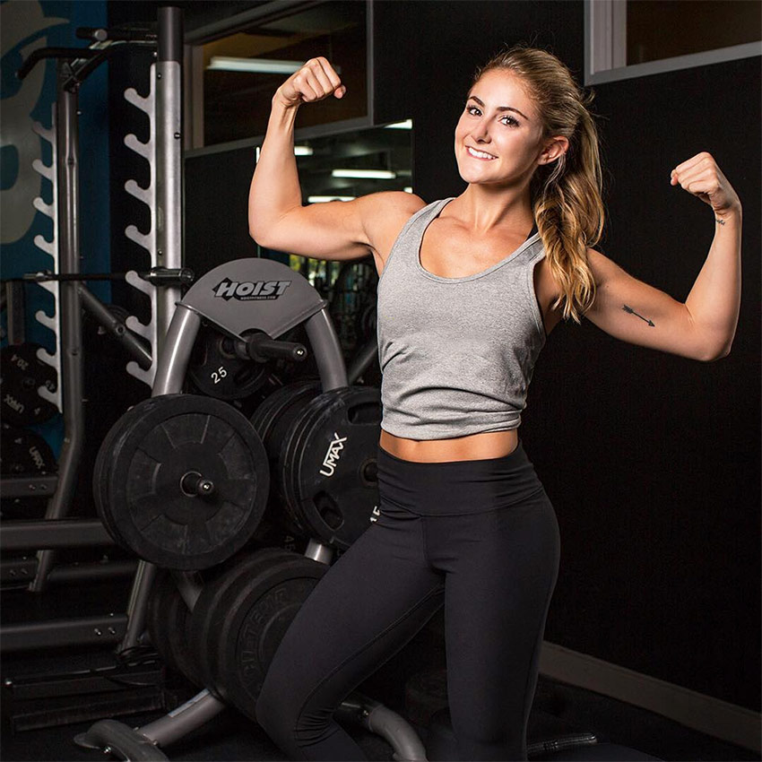 Alex-SIlver-Fagan-tensing-her-double-biceps-for-a-professional-photoshoot