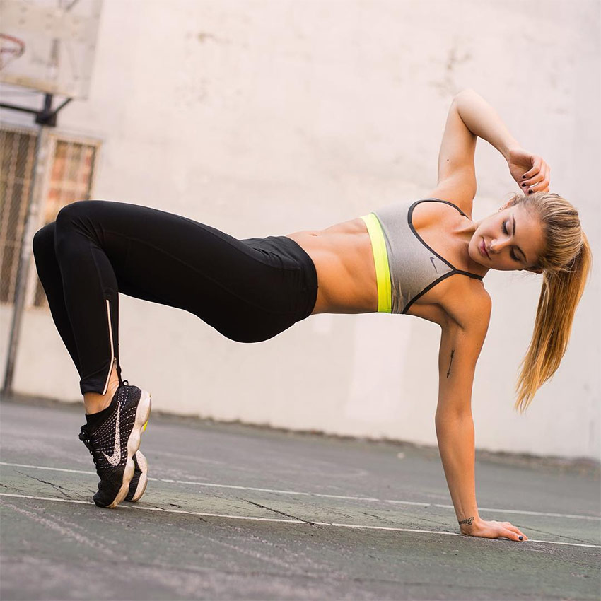 Alex-Silver-Fagan-showing-her-abs-while-stretching