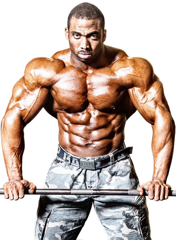 Cedric McMillan showing his biography showing his muscular definition.