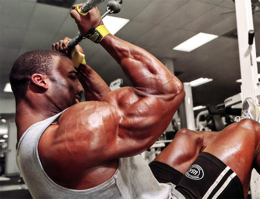 Cedric McMillan training his back and arms in the gym.