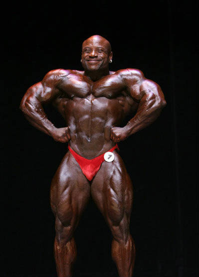 Charles Dixon competing in red trunks