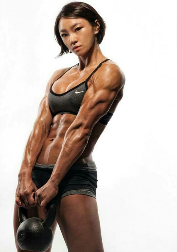 Chu mi Kim holding a kettlebell looking strong and lean