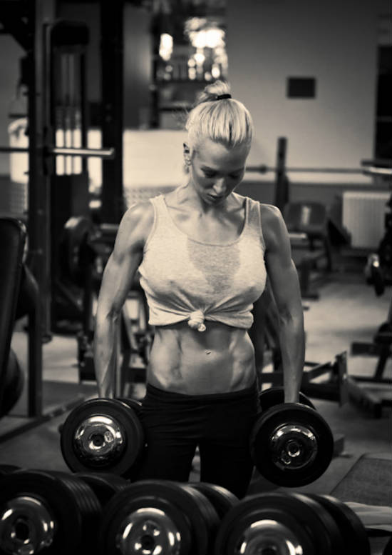 Cornelia Ritzke standing in the gym with dumbbells