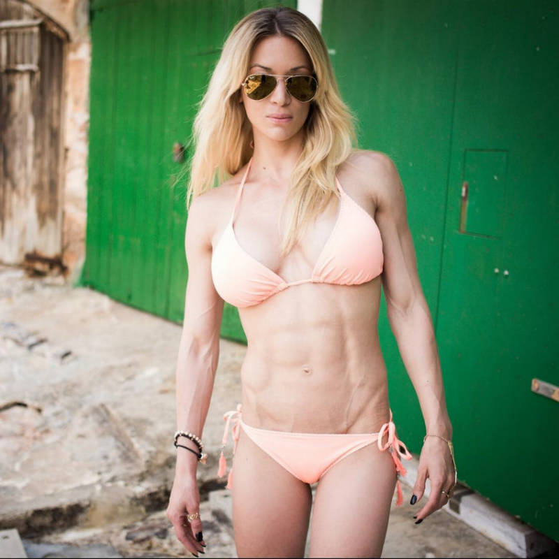 Cornelia standing in peach colored bikini