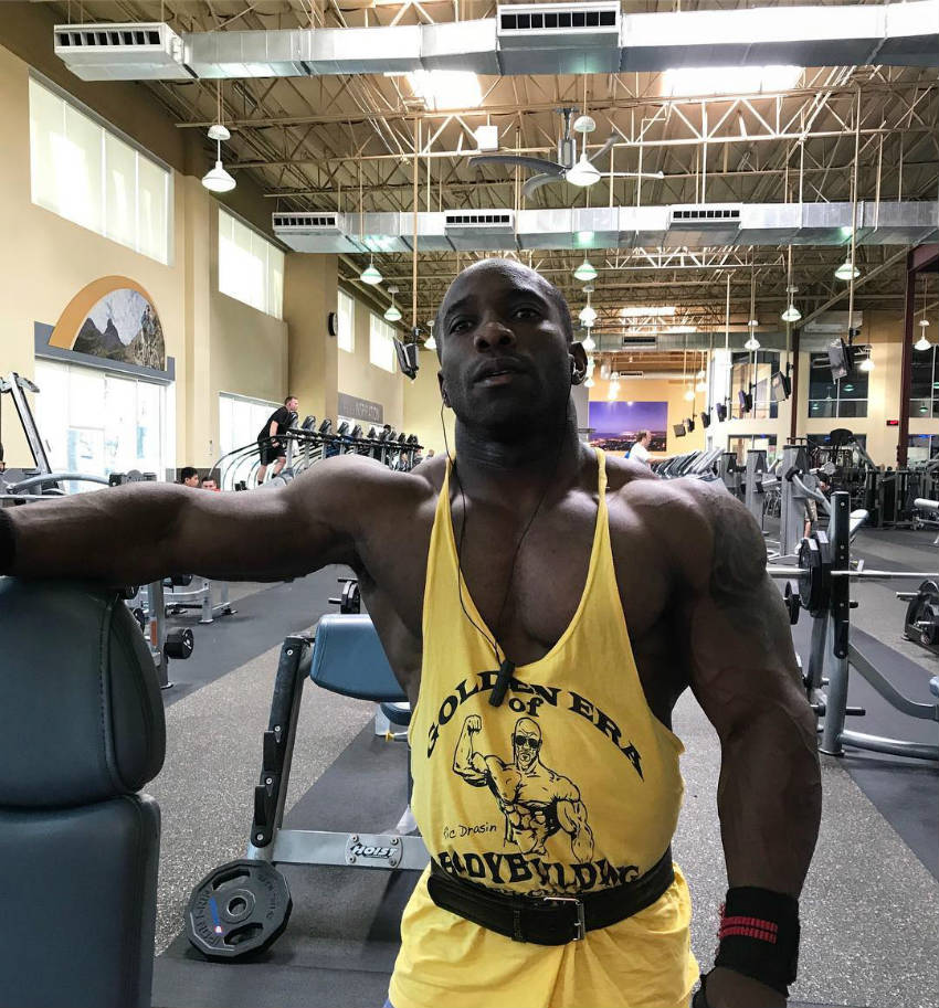 Damion Ricketts working out in a 'golden era of bodybuilding' vest