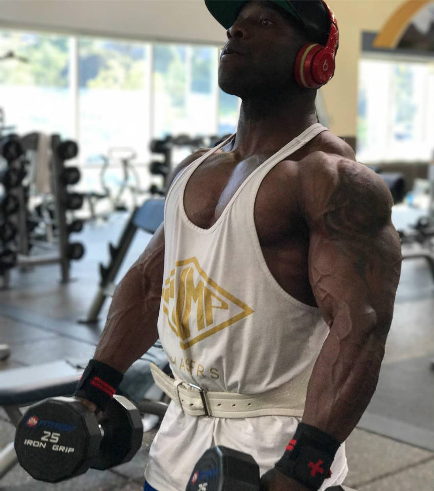 Damion Ricketts getting ready to complete an exercise with two dumbbells