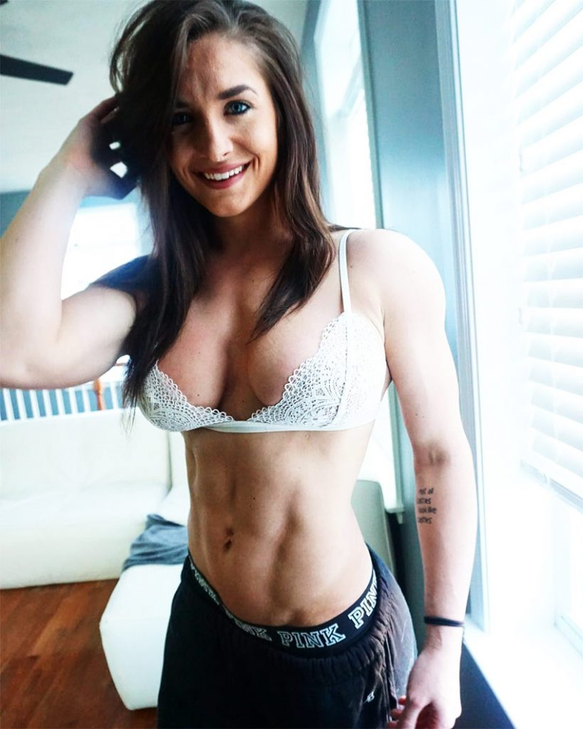 Emeri Connery posing in a bra at home in her bedroom, in sportswear displaying her shredded abs and figure as a bikini athlete.