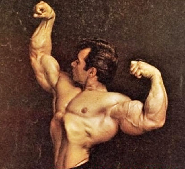 Freddy Ortiz flexing his arms for a professional photoshoot.
