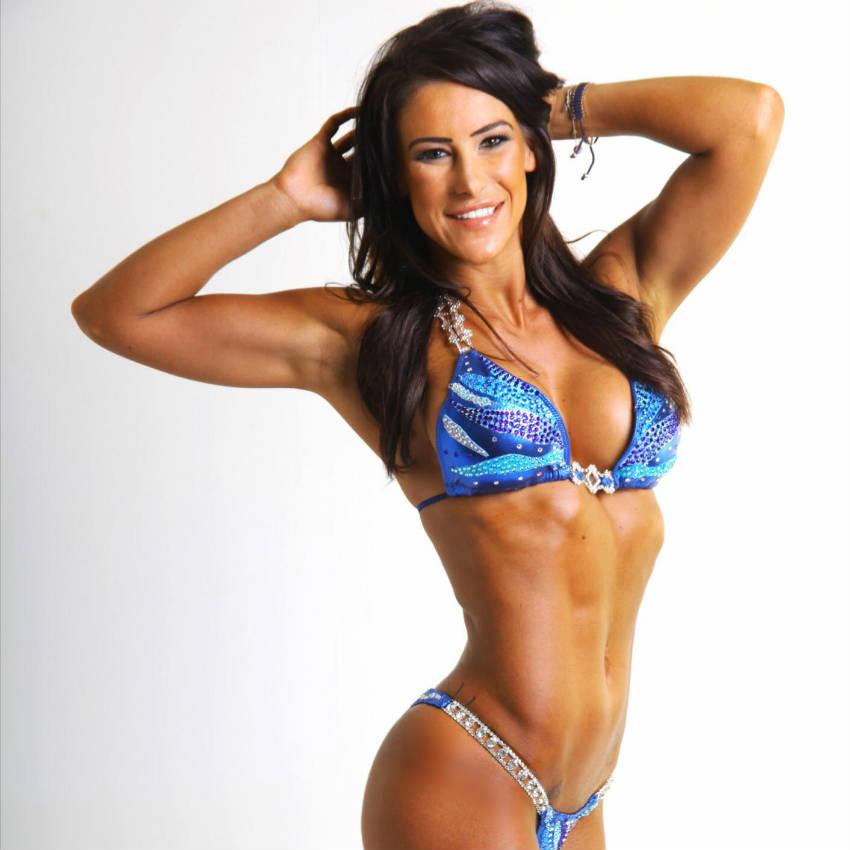 Georgia B Simmons in blue bikini showing her abs