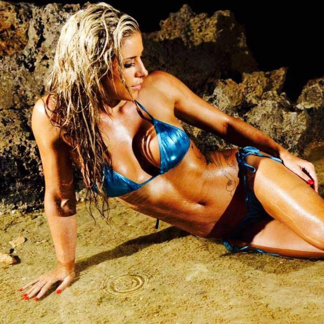 Georgia B Simmons laying on the beach in a bikini
