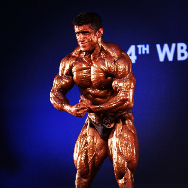Hadi Choopan in a most muscular pose on the stage