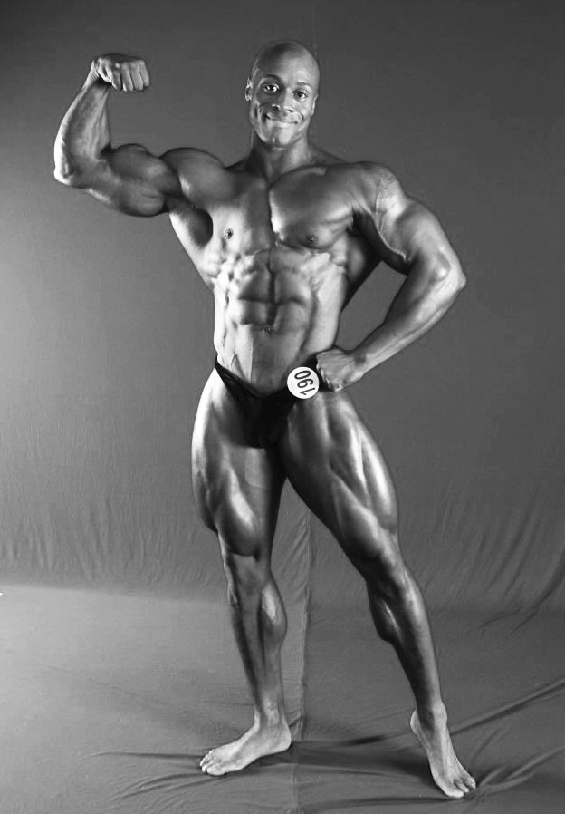 Jeff Beckham posing in his bodybuilding trunks looking ripped and muscular