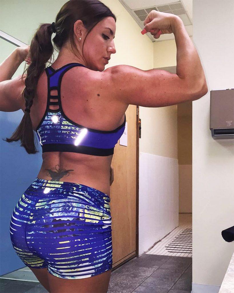Jessica-Kiernan-tensing-her-biceps-in-sportswear