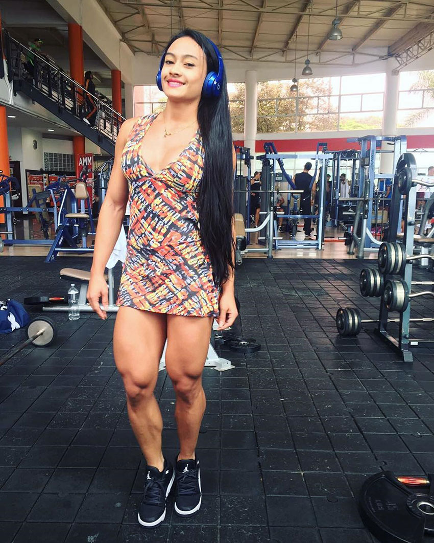 Jessica Olaya standing in the gym showing her strong quads