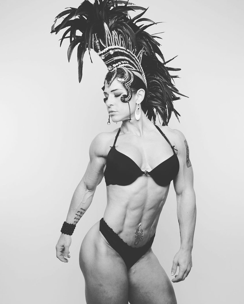 Kortney Olson wearing a party carnaval outfit looking lean and muscular