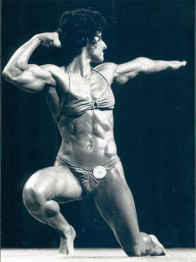Laura Combes showing her figure in her competition, making bodybuilding history.