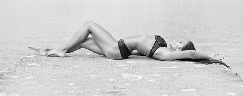 Lone-Noras-Lying-on-a-beach-in-a-bikini-revealing-her-incredible-figure.