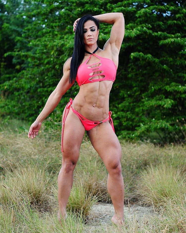 Luz Elena Echeverria Molina standing in a field wearing a pink bikini modelling showing off her strong and healthy physique