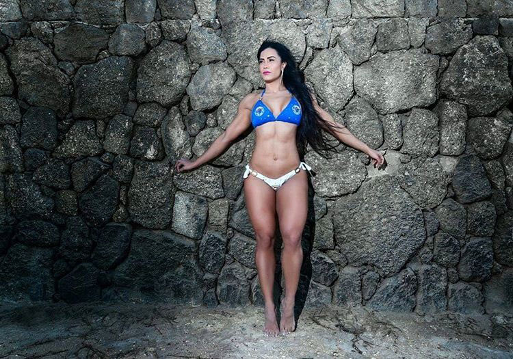 Luz Elena Echeverria Molina stood against a wall while wearing a bikini looking fit and strong