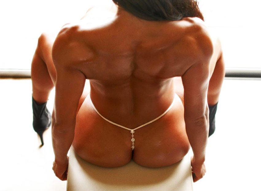 Maria Villalba showing her muscular definition on her back and glutes.