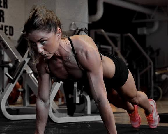 Michaela Augustsson doing pushups in the gym, working on her ripped upper body