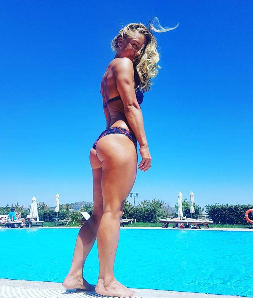 Michaela Augustsson in a bikini by the pool, showing her incredible glutes and legs