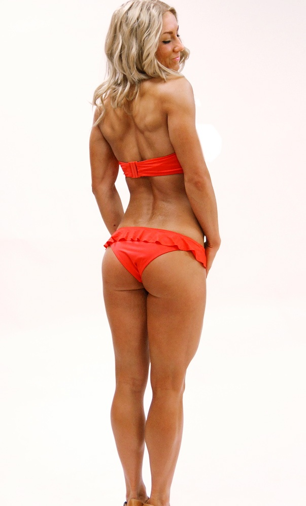 Michaella Augustsson in a red swimsuit, showing her back, legs, and glutes