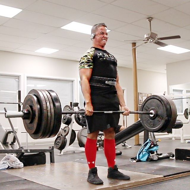 Nick Wright with a pained grimace, doing heavy deadlifts