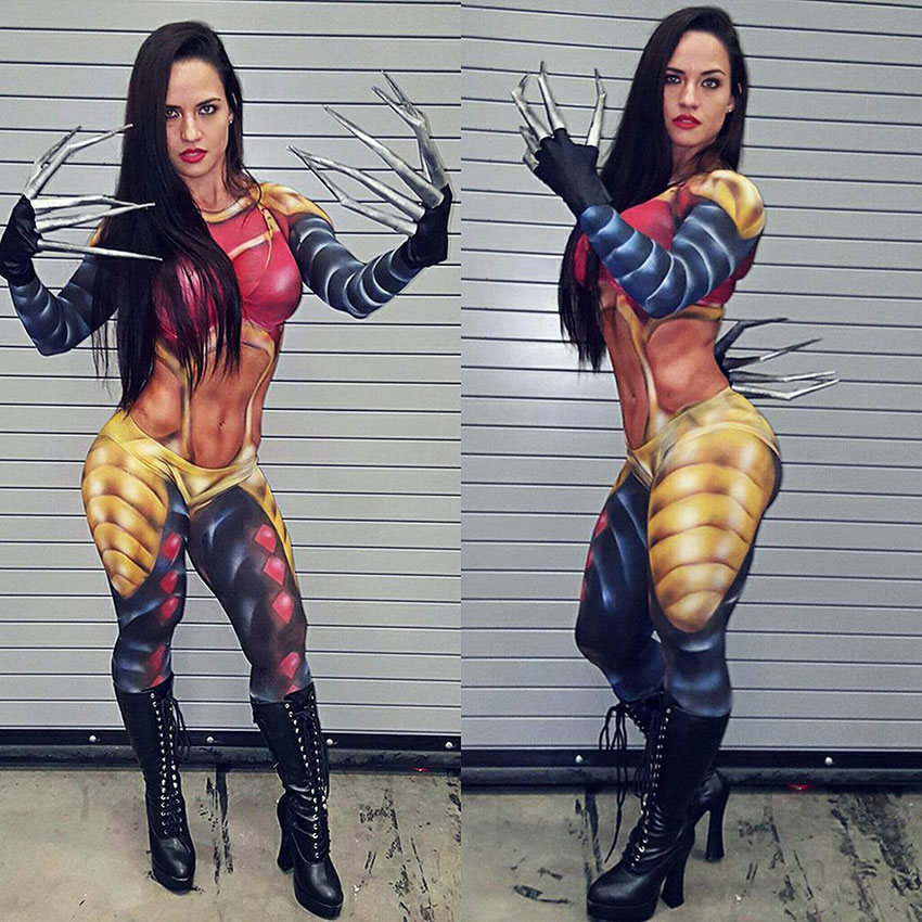 Renee Enos wearing a cosplay outfit with claws while posing and showing her strong muscles