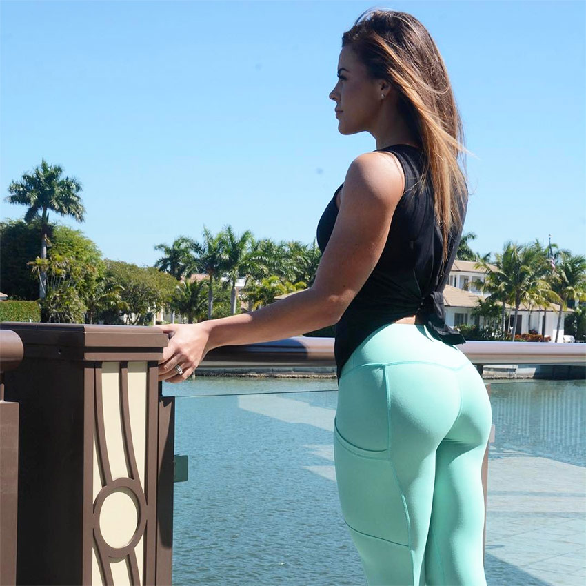 Sami Bossert showing her glutes while looking into the distance in a photoshoot.