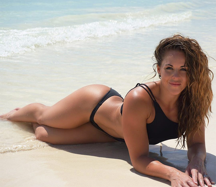 Sami-Bossert-lying-on-the-beach-in-the-sea